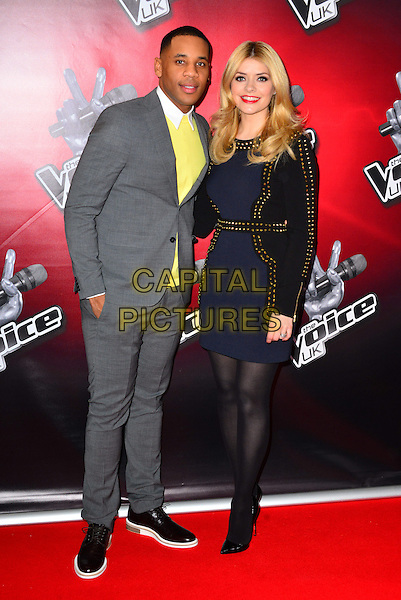 Reggie Yates & Holly Willoughby.The Voice press launch of the second series, which this year includes the option for judges to 'steal' each other's acts. The Soho Hotel, London, England..March 11th, 2013.full length suit top hand in pocket white collar grey gray yellow top  blue black dress gold studs studded tights .CAP/BF.©Bob Fidgeon/Capital Pictures.