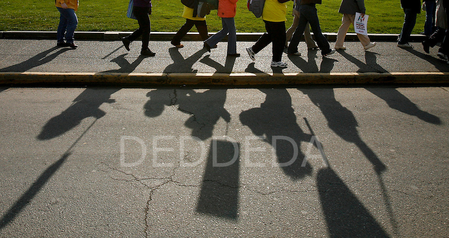 Shadows lines the streets from some protesters as they chant and march to the front lawn of the British Columbia Legislature in Victoria, BC. Photo assignment for Canadian Press (CP) news wire service.