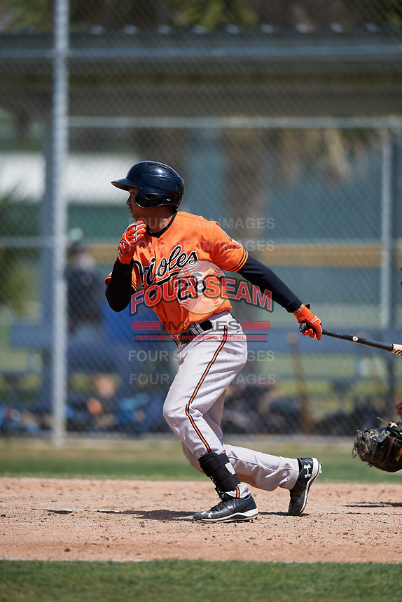 Baltimore Orioles Irving Ortega (26) follows through on a swing during a minor league Spring Training game against the Tampa Bay Rays on March 29, 2017 at the Buck O'Neil Baseball Complex in Sarasota, Florida.  (Mike Janes/Four Seam Images)