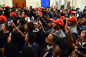 Attendees from the 2018 Young Black Leadership Summit await the arrival of United States President Donald J. Trump in the East Room of the White House, Washington, DC, October 26, 2018.       <br /> Credit: Mike Theiler / CNP