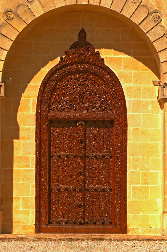 The entrance door to the elaborately decorated winery at Cos d'Estournel in oriental style, Saint St Estephe, Medoc, Bordeaux