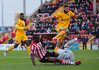 Northampton Town's David Cornell saves at the feet of Lincoln City's John Akinde<br /> <br /> Photographer Chris Vaughan/CameraSport<br /> <br /> Emirates FA Cup First Round - Lincoln City v Northampton Town - Saturday 10th November 2018 - Sincil Bank - Lincoln<br />  <br /> World Copyright © 2018 CameraSport. All rights reserved. 43 Linden Ave. Countesthorpe. Leicester. England. LE8 5PG - Tel: +44 (0) 116 277 4147 - admin@camerasport.com - www.camerasport.com