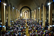"Worshippers attend the evening mass on wednesday evening at the Redemptorist Church in Baclaran in Manila, Philippines. The Baclaran church is said to be the most attended church in Asia drawing up to 100,000 worshippers "" in Manila, Philippines. Photo: Sanjit Das"