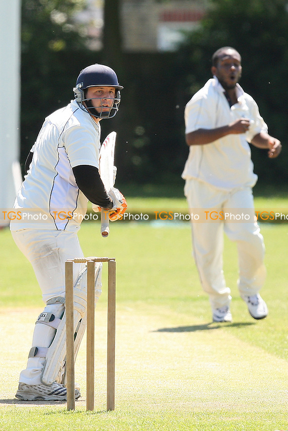 S Smith of Goresbrook sends the ball past the edge of Raftery's bat - Hornchurch Athletic CC vs Goresbrook CC - Lords International Essex League at Hylands Park - 22/05/10 - MANDATORY CREDIT: Gavin Ellis/TGSPHOTO - Self billing applies where appropriate - Tel: 0845 094 6026