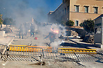 Protesters clash with riot policemen throwed fire bombs and stones outside the Greek parliament. A two-day general strike that unions vow will be the largest in years.