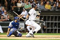 Chicago White Sox outfielder Jordan Danks (20) at bat in front of catcher Dioner Navarro (30) during a game against the Toronto Blue Jays on August 15, 2014 at U.S. Cellular Field in Chicago, Illinois.  Chicago defeated Toronto 11-5.  (Mike Janes/Four Seam Images)