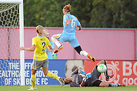 Philadelphia Independence goalkeeper Karina LeBlanc (23) comes off her line to deny Natasha Kai (6) of Sky Blue FC a scoring oportunity during a Women's Professional Soccer (WPS) match at Yurcak Field in Piscataway, NJ, on June 19, 2010.