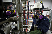 Workers at the Polar Light Company, in the Nenets Autonomous Region in the Russian Arctic, works in toxic condition at the Ardalin field.