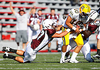 Francis Radici #57 and Razohnn Gross #32 of Don Bosco sack Joe Greco #10 of St Ignatius during the game at Harding Stadium in Steubenville, OH on September 25, 2010. ..Jared Wickerham.