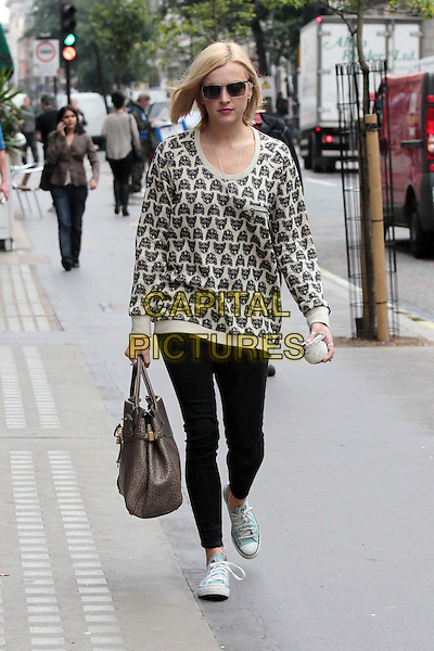 Fearne Cotton arriving at the studios of BBC Radio 1, London, England..July 21st, 2011.full length black leggings white print top jumper sweater sunglasses shades bag purse beige raccoon animal.CAP/HIL.©John Hillcoat/Capital Pictures .