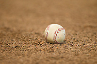 A baseball sits in the dirt behind home plate during the game between the Texas Longhorns and the Tennessee Volunteers at Minute Maid Park on March 3, 2012 in Houston, Texas.  The Volunteers defeated the Longhorns 5-4.  Brian Westerholt / Four Seam Images