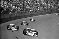 BROOKLYN, MI - SEPTEMBER 18: Al Unser leads a group of cars in his Parnelli VPJ6B 001/Cosworth TC during the Michigan Grand Prix IndyCar race at Michigan International Speedway near Brooklyn, Michigan, on September 18, 1976.