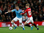 Brandon Williams of Manchester United tackles Kyle Walker of Manchester City during the Carabao Cup match at Old Trafford, Manchester. Picture date: 7th January 2020. Picture credit should read: Darren Staples/Sportimage