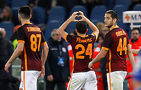 Calcio, Serie A: Roma vs Sampdoria. Roma, stadio Olimpico, 7 febbraio 2016.<br /> Roma&rsquo;s Alessandro Florenzi, center, celebrates with teammates Ervin Zukanovic, left, and Kostas Manolas, after scoring during the Italian Serie A football match between Roma and Sampdoria at Rome's Olympic stadium, 7 January 2016.<br /> UPDATE IMAGES PRESS/Riccardo De Luca