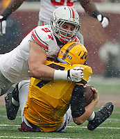 Ohio State Buckeyes defensive lineman Joey Bosa (97) sacks Minnesota Golden Gophers quarterback Mitch Leidner (7) during the 1st quarter at TCF Bank Stadium in Minneapolis, Minn. on November 15, 2014.  (Dispatch photo by Kyle Robertson)