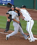 Reno Aces' Mike Jacobs holds a Salt Lake runner on first during a minor league baseball game in Reno, Nev., on Sunday, Aug. 25, 2013. The Salt Lake Bees won 9-1. <br /> Photo by Cathleen Allison