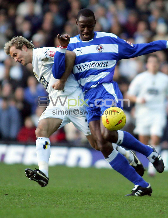 Pix, Shaun Flannery/SWpix. Coca-Cola League Championship. Leeds United v Reading, 12.2.2005...COPYRIGHT PICTURE>>SIMON WILKINSON>>01943 - 608782>>..Reading's Ibrahima Sonko holds off Leeds Michael Gray.