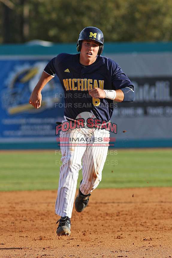 John Lorenz #6 running in the field during a game for the University of Michigan Wolverines against the Coastal Carolina University Chanticleers at the Carvelle Resort Classic Tournament held at Watson Stadium at Vrooman Field in Conway, SC on March 13, 2010. Photo by Robert Gurganus/Four Seam Images