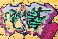 A chameleon woman on a street graffiti
