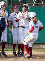 STANFORD, CA - February 25, 2011:  Ashley Hansen is welcomed at home after her 3rd inning home run in Stanford's 12-0 victory over North Dakota State at Stanford, California on February 25, 2011.