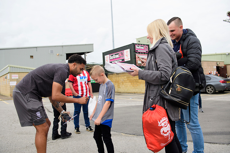Lincoln City's Bruno Andrade signs an autograph for a fan after arriving at the ground<br /> <br /> Photographer Chris Vaughan/CameraSport<br /> <br /> The EFL Sky Bet League One - Lincoln City v Sunderland - Saturday 5th October 2019 - Sincil Bank - Lincoln<br /> <br /> World Copyright © 2019 CameraSport. All rights reserved. 43 Linden Ave. Countesthorpe. Leicester. England. LE8 5PG - Tel: +44 (0) 116 277 4147 - admin@camerasport.com - www.camerasport.com