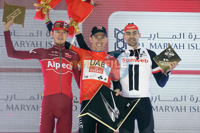 The final podium overall race winner (centre) Rui Costa (POR) UAE Abu Dhabi team, 2nd place Ilnur Zakarin (RUS) Team Katusha Alpecin and 3rd Tom Dumoulin (NED) Team Sunweb at the end of Stage 4 Yas Island Stage of the 2017 Abu Dhabi Tour, 143km with 26 laps of 5.5km of the Yas Marina Circuit, Abu Dhabi. 26th February 2017<br /> Picture: ANSA/Matteo Bazzi | Newsfile<br /> <br /> <br /> All photos usage must carry mandatory copyright credit (&copy; Newsfile | ANSA)