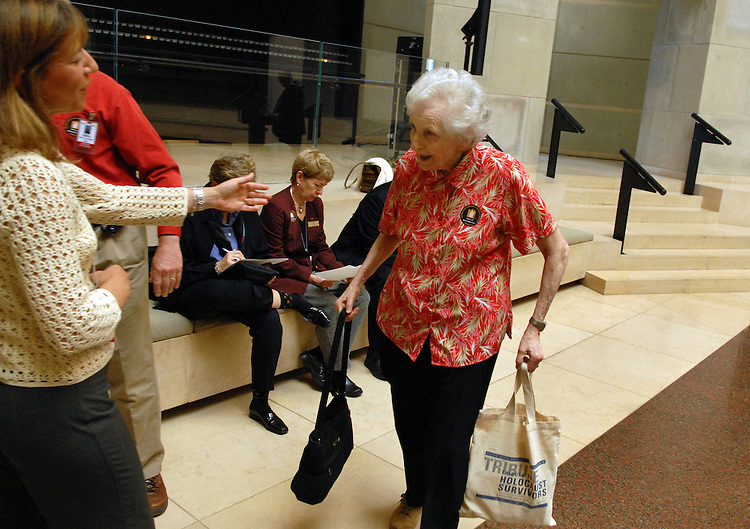 Hilda Seftor, 82, of Annandale, is greeted by Wendy Rudolph a volunteer for the U.S. Holocaust Memorial Museum after Seftor read names of Holocaust victims on Holocaust Remembrance Day at the museum.  Seftor, originally from Scotland, housed two Austrian boys who fled the Holocaust, during World War II.