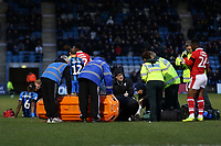 A stretcher is brought onto the pitch for Barnsley's Kieffer Moore after suffering a nasty injury from a clash of heads during Gillingham vs Barnsley, Sky Bet EFL League 1 Football at The Medway Priestfield Stadium on 9th February 2019