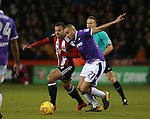 Samir Carruthers of Sheffield Utd tackles Darren Pratley of Bolton Wanderers during the Championship match at Bramall Lane Stadium, Sheffield. Picture date 30th December 2017. Picture credit should read: Simon Bellis/Sportimage