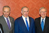 A bipartisan group of United States Senators pose for a photo with Prime Minister Benjamin Netanyahu in the US Capitol in Washington, DC on Wednesday, February 15, 2017.  From left to right: US Senate Minority Leader Chuck Schumer (Democrat of New York); Prime Minister Netanyahu; and US Senate Majority Leader Mitch McConnell (Republican of Kentucky).<br /> Credit: Ron Sachs / CNP