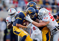 Ohio State Buckeyes defensive lineman Noah Spence (8) and defensive lineman Joey Bosa (97) team up to sack California Golden Bears quarterback Jared Goff (16) during the third quarter of the NCAA football game at Memorial Stadium in Berkeley, California on Sept. 14, 2013. (Adam Cairns / The Columbus Dispatch)