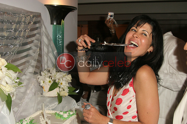 Maria Conchita Alonso has a taste of her cake<br />