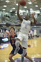 NWA Democrat-Gazette/ANDY SHUPE<br /> Darius Bowers (5) of Fayetteville reaches to score ahead of Dawson Peek of Heritage Tuesday, Feb. 13, 2018, during the first half of play in Bulldog Arena in Fayetteville. Visit nwadg.com/photos to see more photographs from the games.