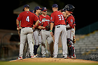 Fort Myers Miracle manager Toby Gardenhire (33) gives the ball to relief pitcher Tom Hackimer (17) as Ryan Costello (13) and catcher Ben Rortvedt look on during a Florida State League game against the Bradenton Marauders on April 23, 2019 at LECOM Park in Bradenton, Florida.  Fort Myers defeated Bradenton 2-1.  (Mike Janes/Four Seam Images)