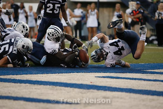 Trent Nelson  |  The Salt Lake Tribune.Utah State's Derrvin Speight runs the ball during the first half. Speight was ruled down on the one-yard line. BYU linebacker Brandon Ogletree (44) at right. Utah State vs. BYU college football in Logan Friday, October 1, 2010.