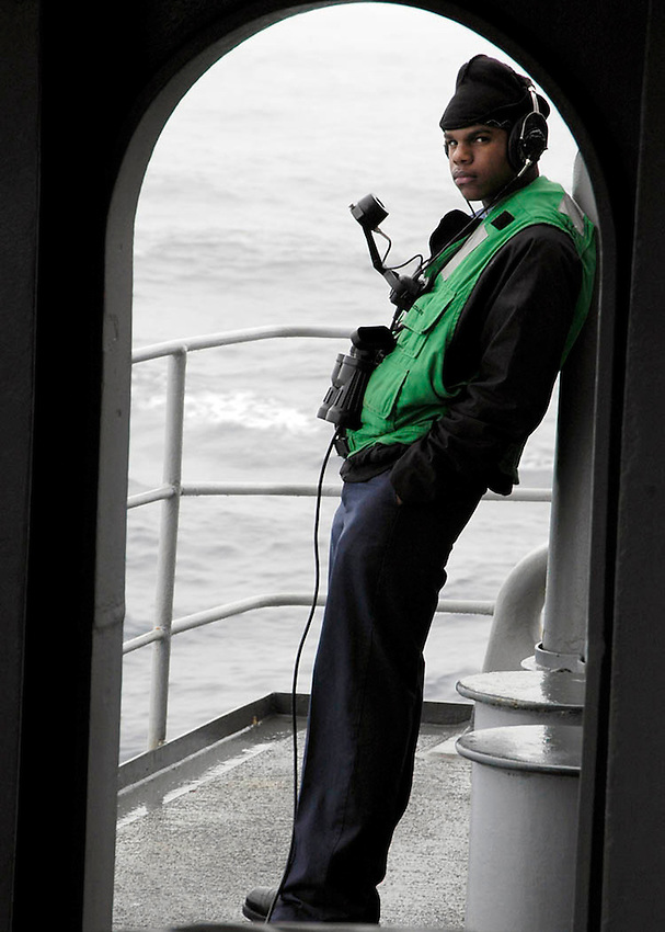 060106-N-7981E-017 Pacific Ocean (January 6, 2006) - A sailor stands watch on the fantail of the USS Abraham Lincoln (CVN 72). USS Abraham Lincoln is underway off the coast of Southern California for a Board of Inspection and Survey (INSURV) inspection and the final Fleet Response Plan (FRP) readiness training before a scheduled deployment later this spring. U.S. Navy photo by Photographer's Mate Airman Apprentice James Evans (RELEASED)