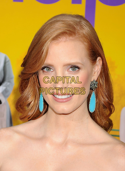 "Jessica Chastain.arriving at the Los Angeles Premiere of ""The Help"" at the Samuel Goldwyn Theater inside the Academy of Motion Picture Arts and Sciences in Beverly Hills, California, USA, August 9th 2011..portrait headshot turquoise earrings   strapless .CAP/ROT/TM.©TM/Roth Stock/Capital Pictures"