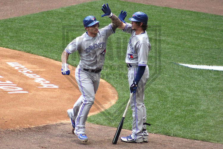 MILWAUKEE - June 2012: Brett Lawrie (13) and Colby Rasmus of the Toronto Blue Jays during a game against the Milwaukee Brewers on June 18, 2012 at Miller Park in Milwaukee, Wisconsin. (Photo by Brad Krause). ..