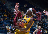Gennifer Brandon of California controls during the game against Washington State at Haas Pavilion in Berkeley, California on February 27th, 2014.   California defeated Washington State, 75-68.