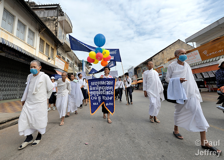 Buddhist nuns participate in a march to commemorate World AIDS Day held in Battambang, Cambodia. Among sponsors of the march was the Salvation Centre Cambodia, an organization that works with Buddhist monks and other activists to foster support for people living with HIV and AIDS as well as public education and advocacy throughout the country.