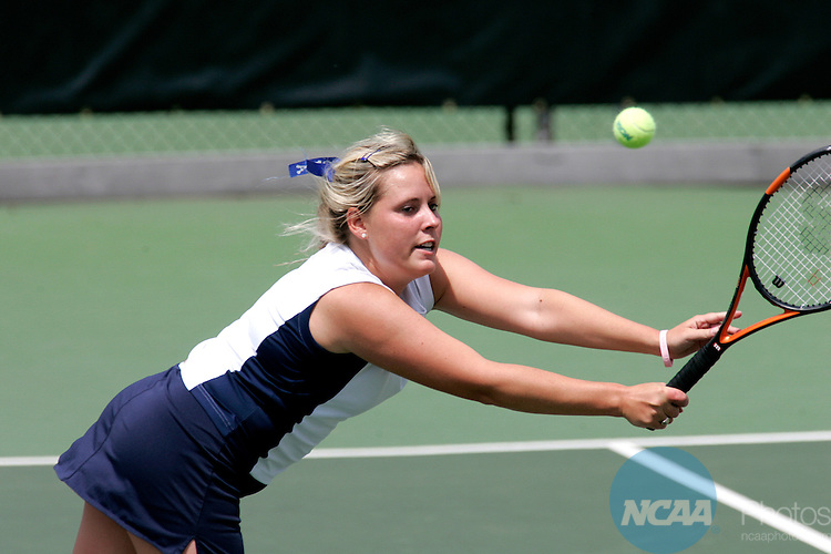 20 MAY 2005:  Lora Farris of Washington & Lee University dives for a shot during the 2005 Division III Women's Tennis Championships held on the Kalamazoo College campus in Kalamazoo, MI.  Farris and her doubles partner Leah Weston were defeated by the Emory team of Indu Anand and Lindsay Tiemeyer.  Emory went on to win the championship beating Washington & Lee 5-3.