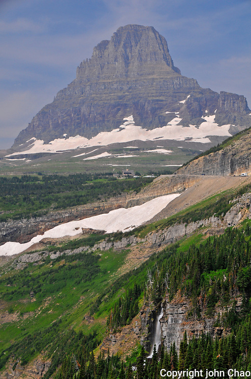 View of Clements Mountain at Logan Pass, with roadway and waterfall, Glacier National Park, Montana