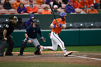 First baseman Grayson Byrd (4) of the Clemson Tigers bats in a game against the South Alabama Jaguars on Opening Day, Friday, February 15, 2019, at Doug Kingsmore Stadium in Clemson, South Carolina. Clemson won, 6-2. (Tom Priddy/Four Seam Images)