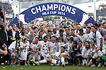 07 December 2014: The Los Angeles Galaxy players and staff pose with the Philip F. Anschutz Trophy. The Los Angeles Galaxy played the New England Revolution in Carson, California in MLS Cup 2014. Los Angeles won 2-1 in overtime.