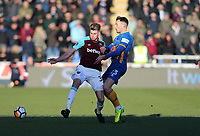 West Ham United's Reece Burke and Shrewsbury Town's Alex Rodman<br /> <br /> Photographer Rob Newell/CameraSport<br /> <br /> The Emirates FA Cup Third Round - Shrewsbury Town v West Ham United - Sunday 7th January 2018 - New Meadow - Shrewsbury<br />  <br /> World Copyright &copy; 2018 CameraSport. All rights reserved. 43 Linden Ave. Countesthorpe. Leicester. England. LE8 5PG - Tel: +44 (0) 116 277 4147 - admin@camerasport.com - www.camerasport.com