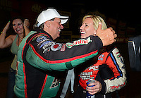 Sept. 1, 2012; Claremont, IN, USA: NHRA funny car driver Courtney Force (right) is congratulated by father John Force after qualifying number one during qualifying for the US Nationals at Lucas Oil Raceway. Mandatory Credit: Mark J. Rebilas-