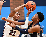 Belleville West forward Ty Lampley (left) grapples for a rebound with Belleville East guard Jordan Pickett. Belleville West played Belleville East  in a Class 4A boys basketball semifinal game at Belleville East High School in Belleville, Illinois on Wednesday March 4, 2020. <br /> Tim Vizer/Special to STLhighschoolsports.com