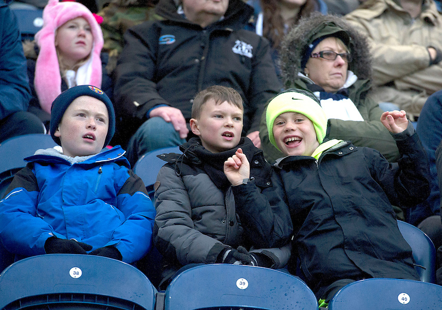 Preston North End fans watch their team draw 1-1 with Milton Keynes Dons<br /> <br /> Photographer Stephen White/CameraSport<br /> <br /> Football - The Football League Sky Bet League One - Preston North End v Milton Keynes Dons - Saturday 13th December 2014 - Deepdale - Preston<br /> <br /> &copy; CameraSport - 43 Linden Ave. Countesthorpe. Leicester. England. LE8 5PG - Tel: +44 (0) 116 277 4147 - admin@camerasport.com - www.camerasport.com