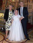 Milly O'Brien from St Oliver's school who received her first holy communion at St Peters chuch pictured with grandparents Tony and Noleen O'Brien. Photo:Colin Bell/pressphotos.ie