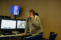Journalists use computer work stations outside of President Vladimir Putin's annual press conference in Moscow, Russia. The press conference lasted 5 hours.